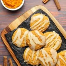 Vegan pumpkin cookies on black tissue paper.
