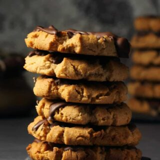 Vegan almond butter cookies in a stack.