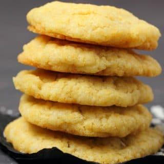 Vegan coconut cookies in a stack.
