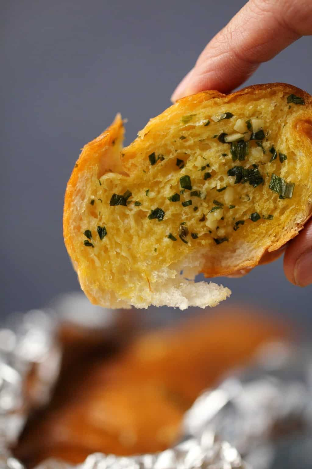 A slice of vegan garlic bread.