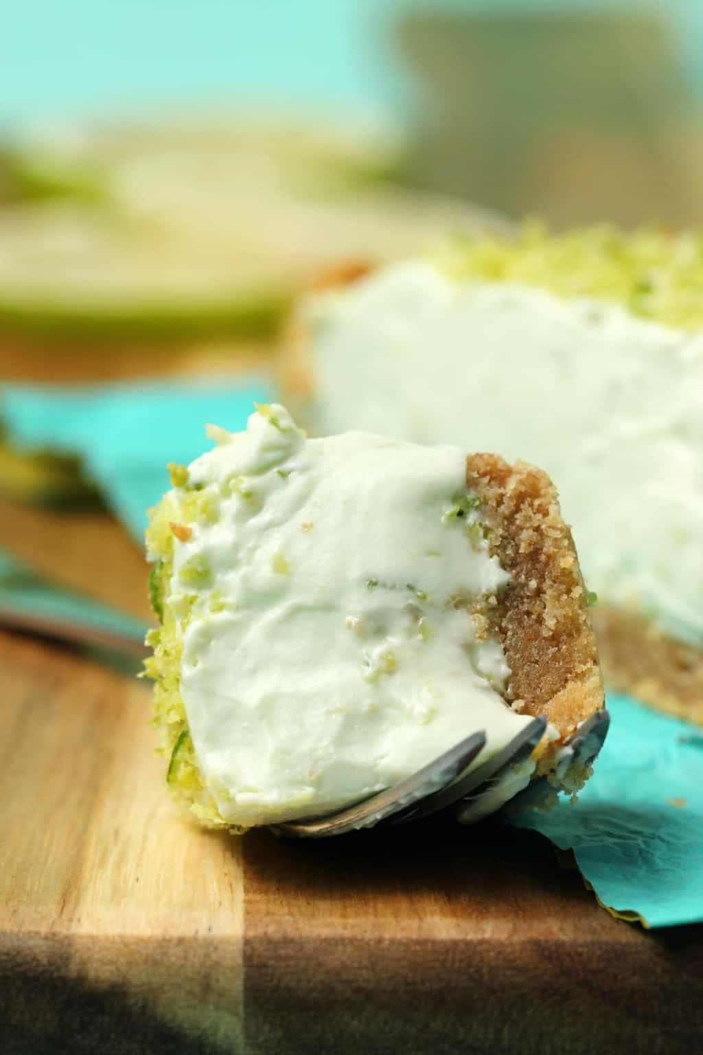 A cake fork with vegan key lime pie.