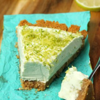 Slice of vegan key lime pie on a napkin with a cake fork.