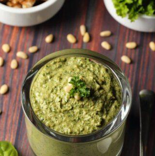 Vegan pesto in a glass jar.