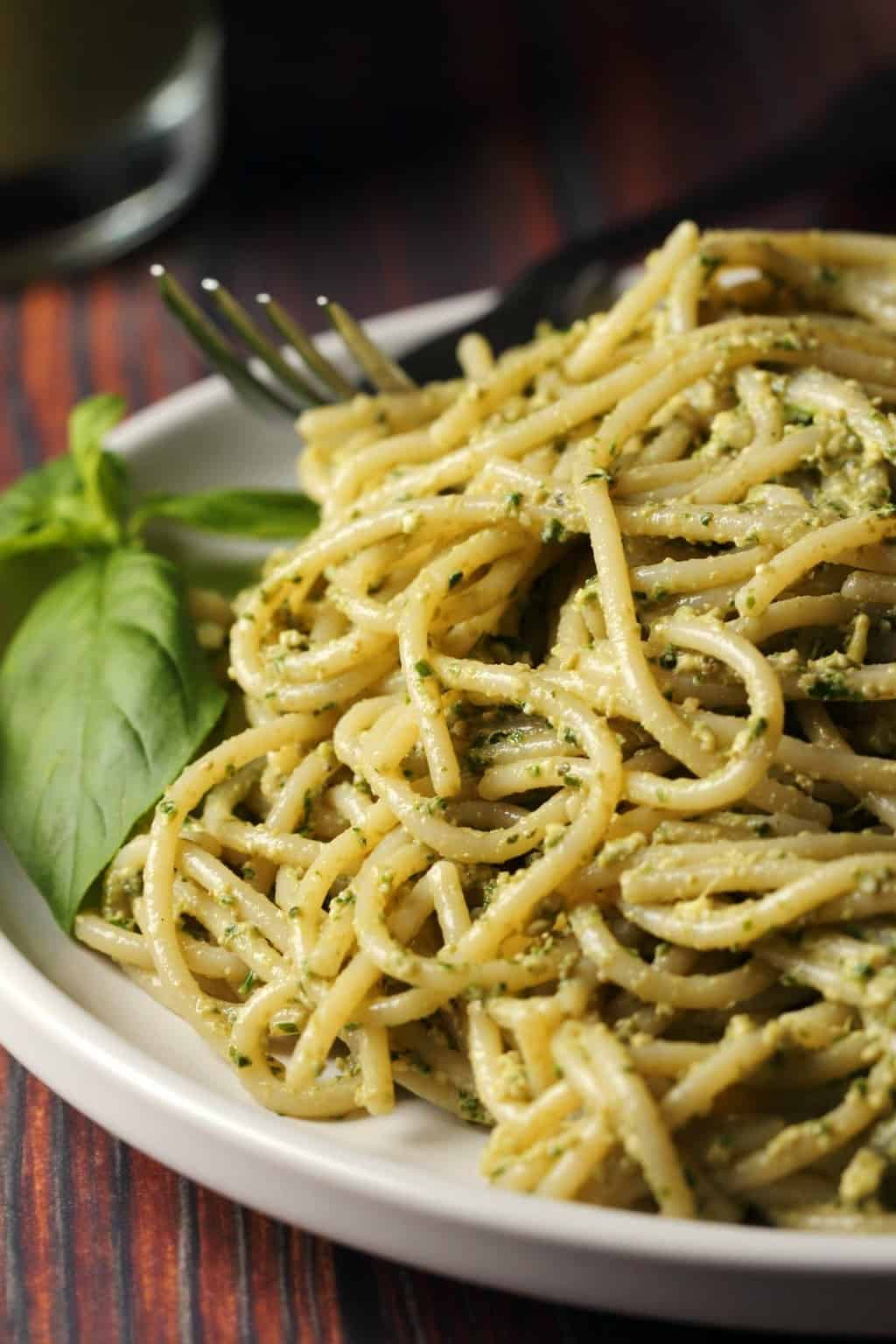 Vegan pesto with pasta on a white plate.