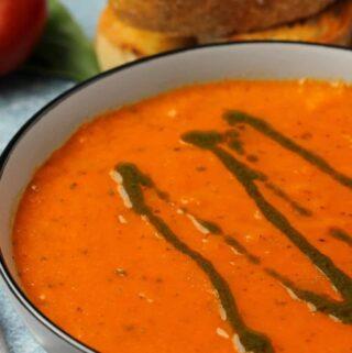 Vegan tomato basil soup in a ceramic bowl.