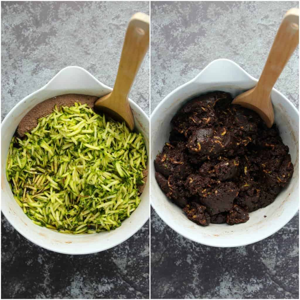 Mixing up the batter for vegan zucchini brownies in a white mixing bowl with a wooden spoon.