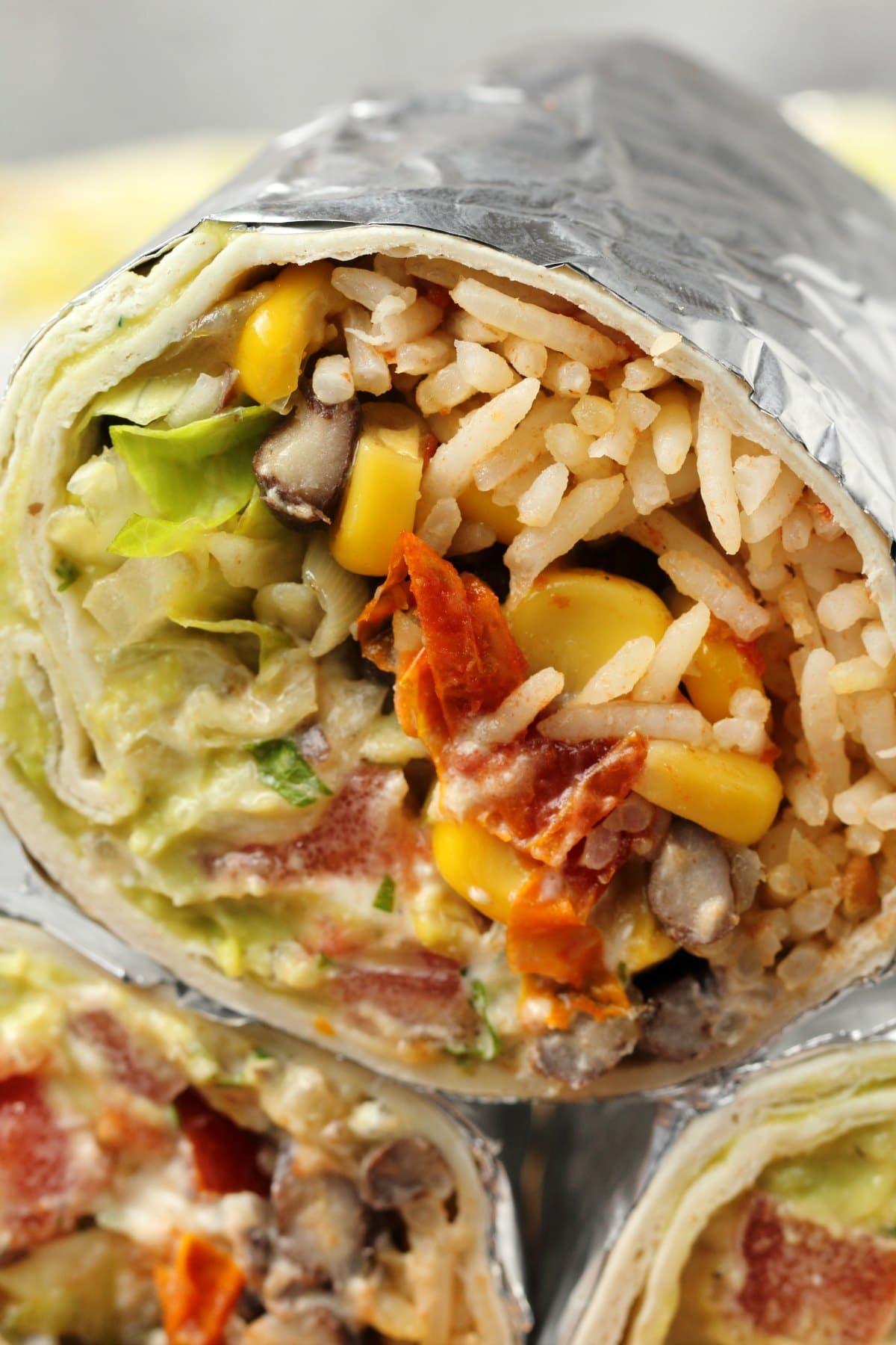 Vegan burritos stacked up.