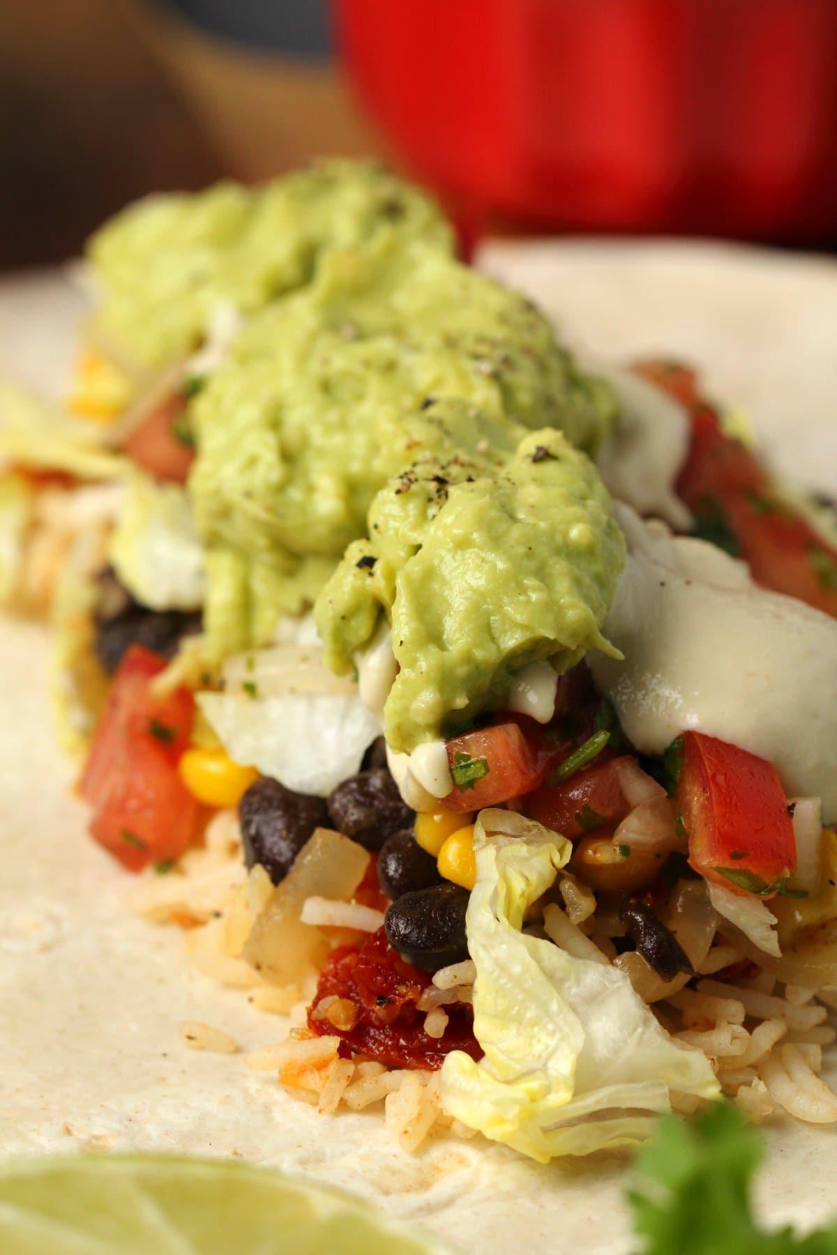 Assembling a vegan burrito.