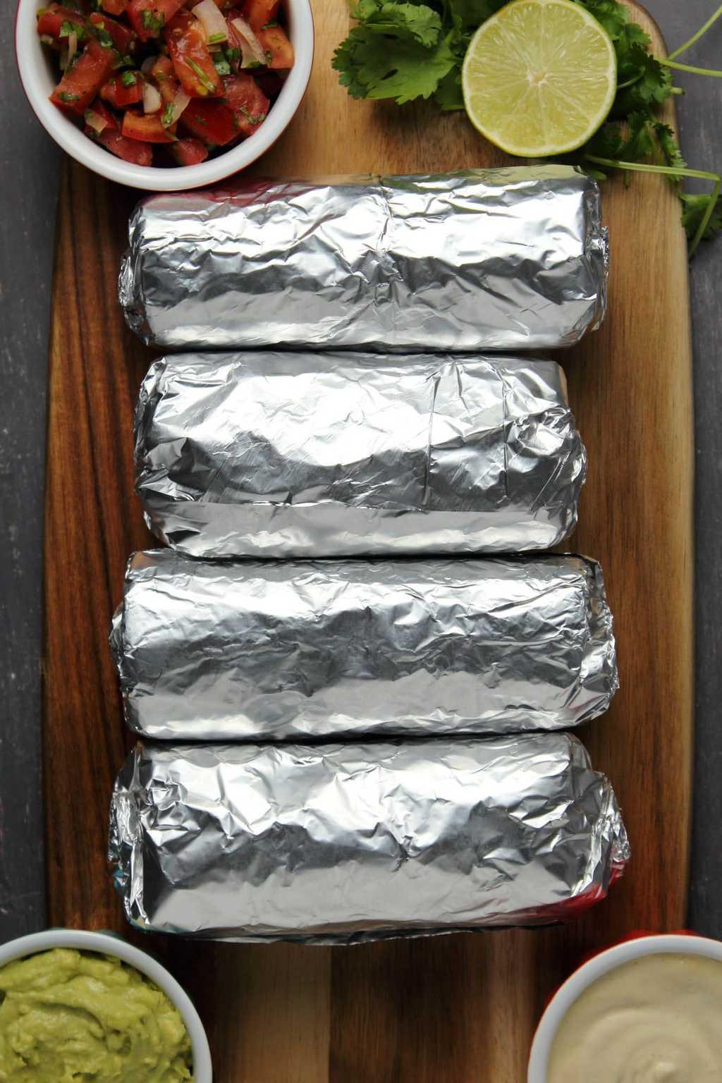 Vegan burritos wrapped in foil.