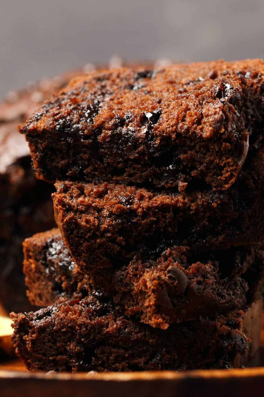 Slices of vegan chocolate banana bread in a stack.