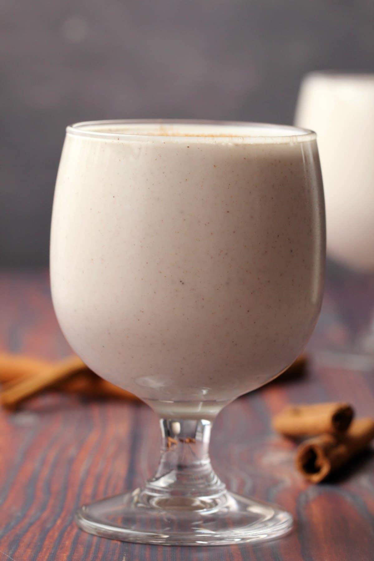 Vegan eggnog in a glass.