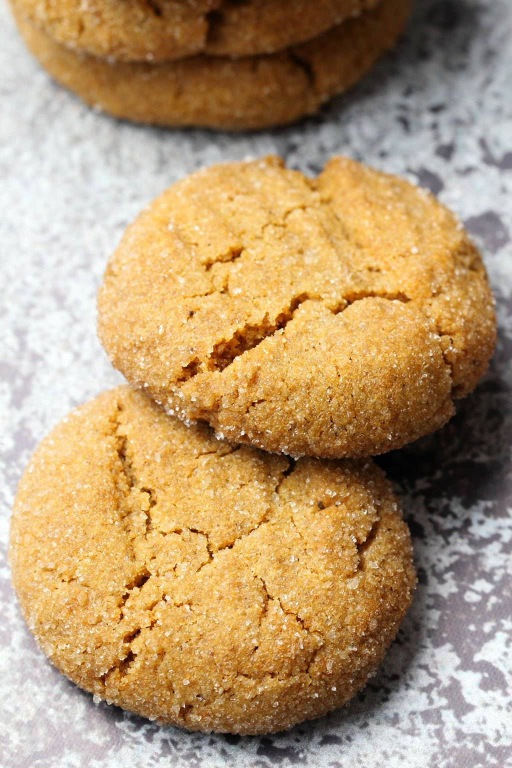 Vegan molasses cookies lying side by side.