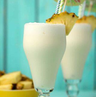 Vegan pina colada in glasses with straws.