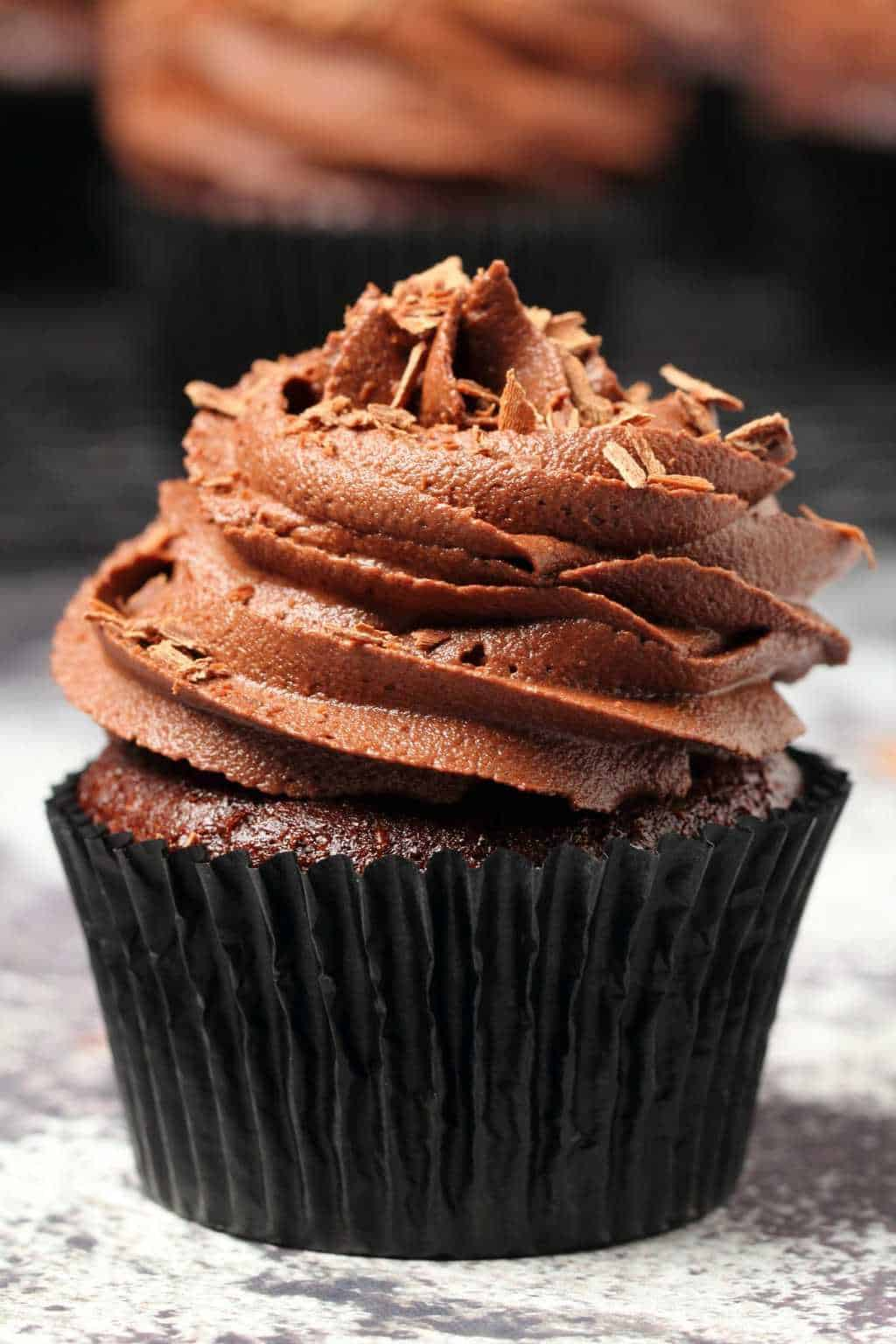 Classic vegan chocolate cupcakes topped with vegan chocolate buttercream and chocolate shavings.