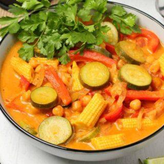 Vegan coconut curry with fresh cilantro in a ceramic bowl.