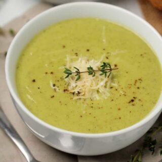 Vegan zucchini soup in a white bowl.