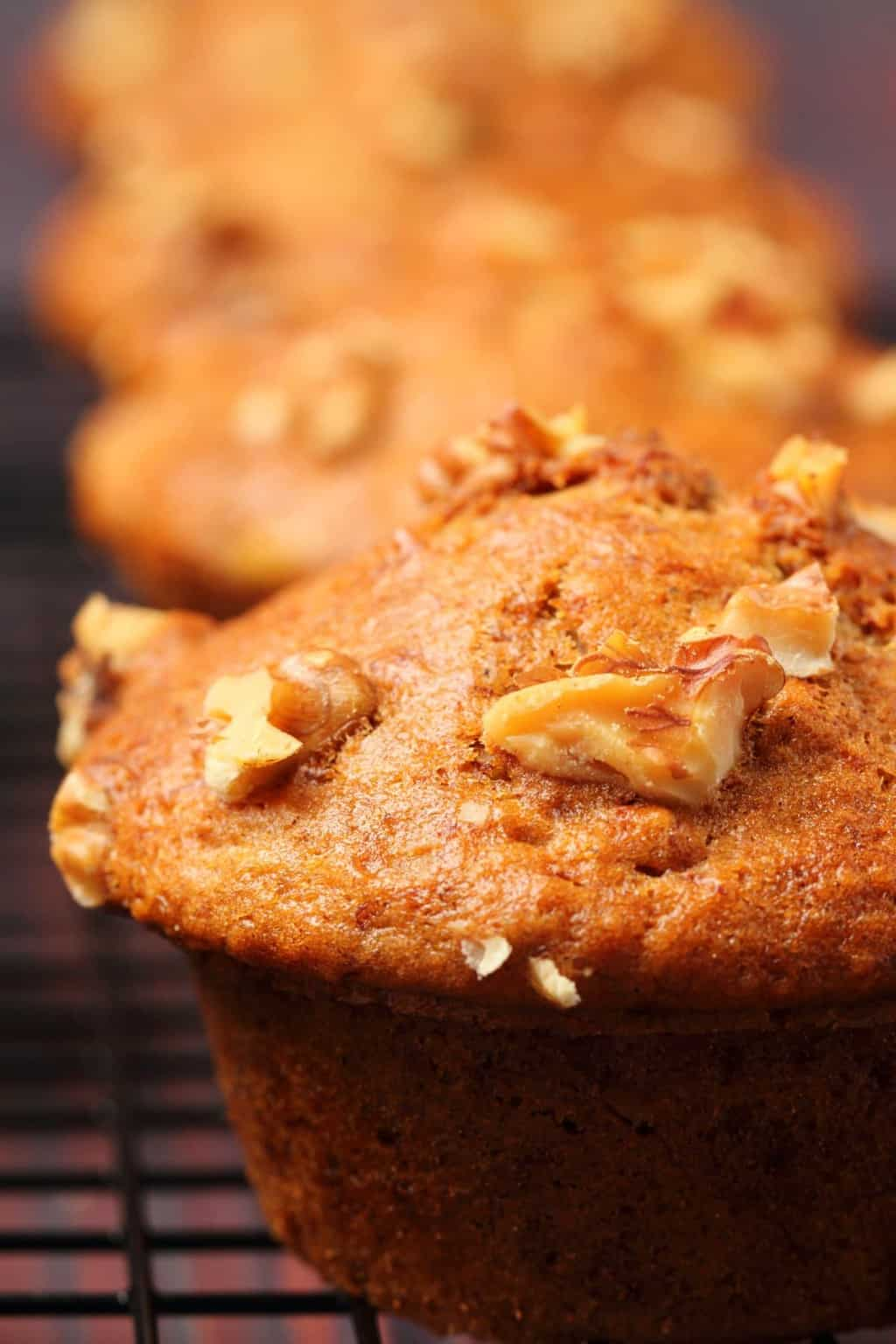 Vegan banana muffins on a wire cooling rack.