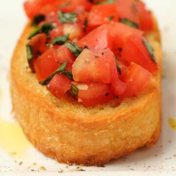 Vegan bruschetta on a white plate.