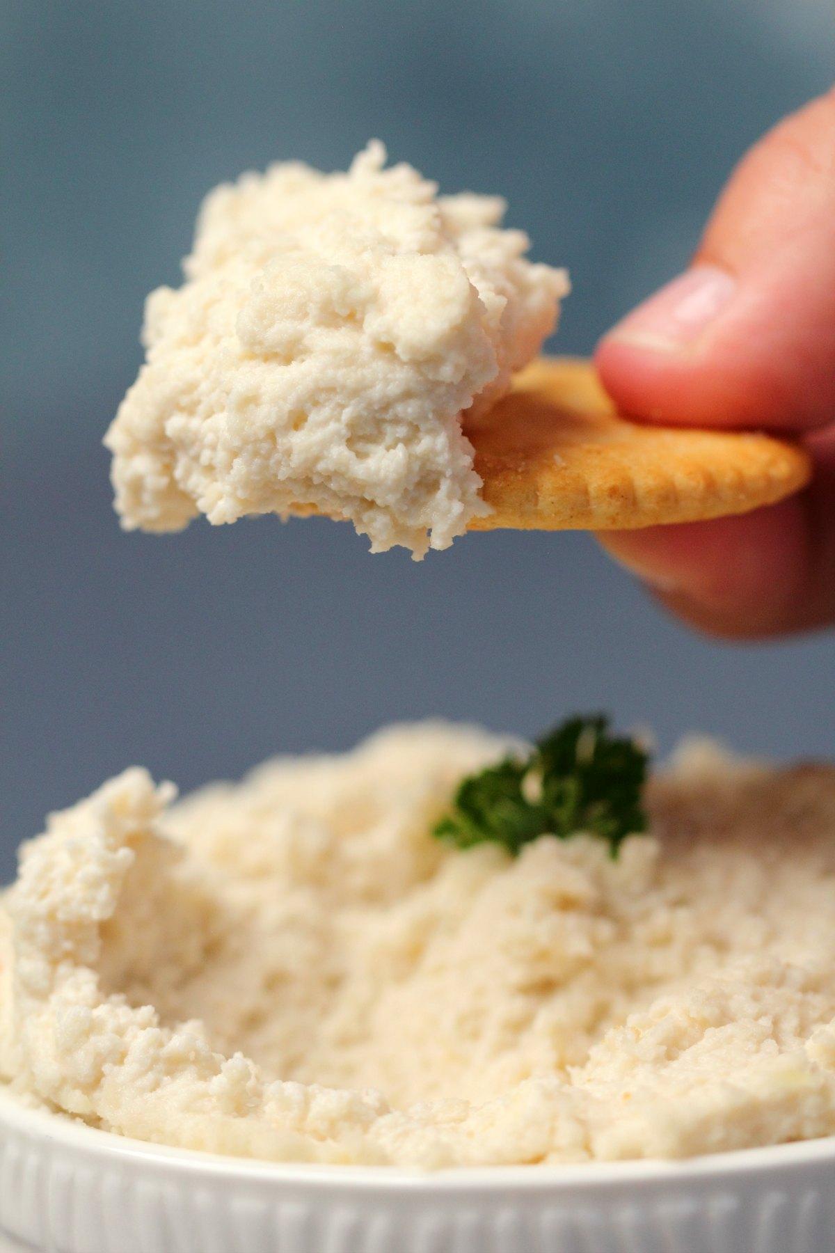 Vegan ricotta on a cracker.