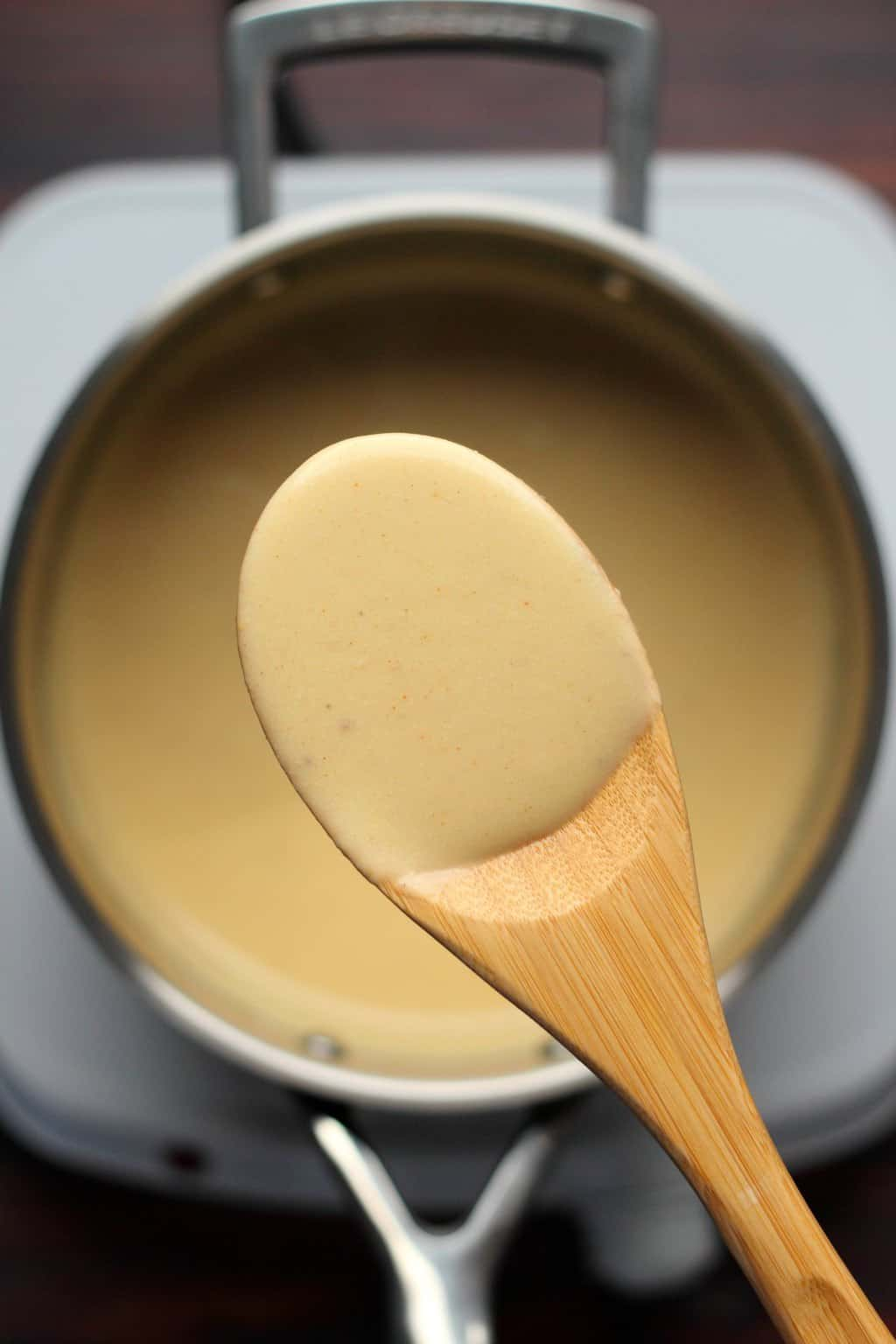 Vegan cheese sauce in a pot.