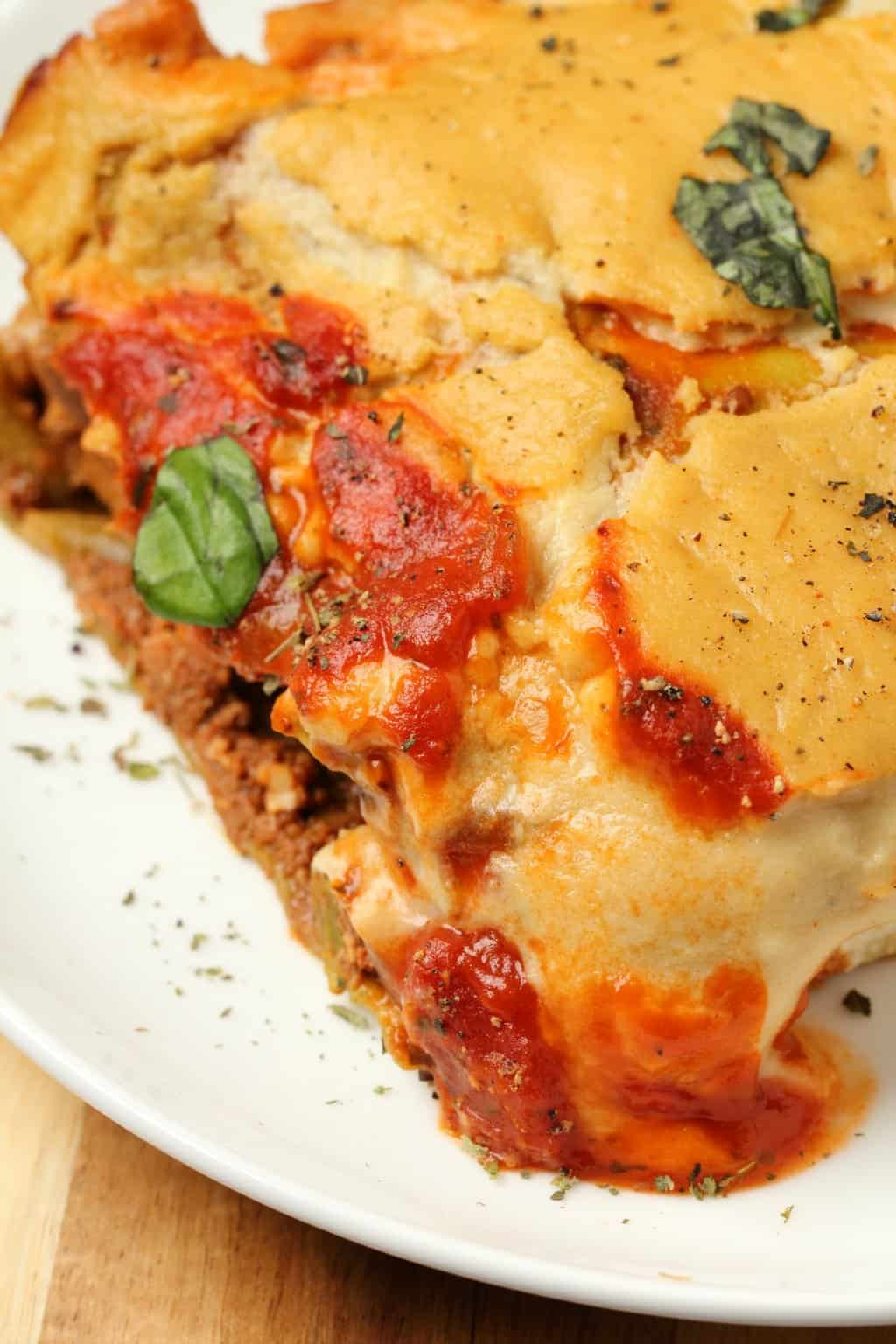 Slice of vegan lasagna on a white plate.
