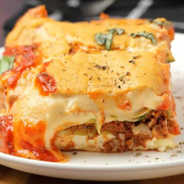 Slice of vegan lasagna on a white plate.