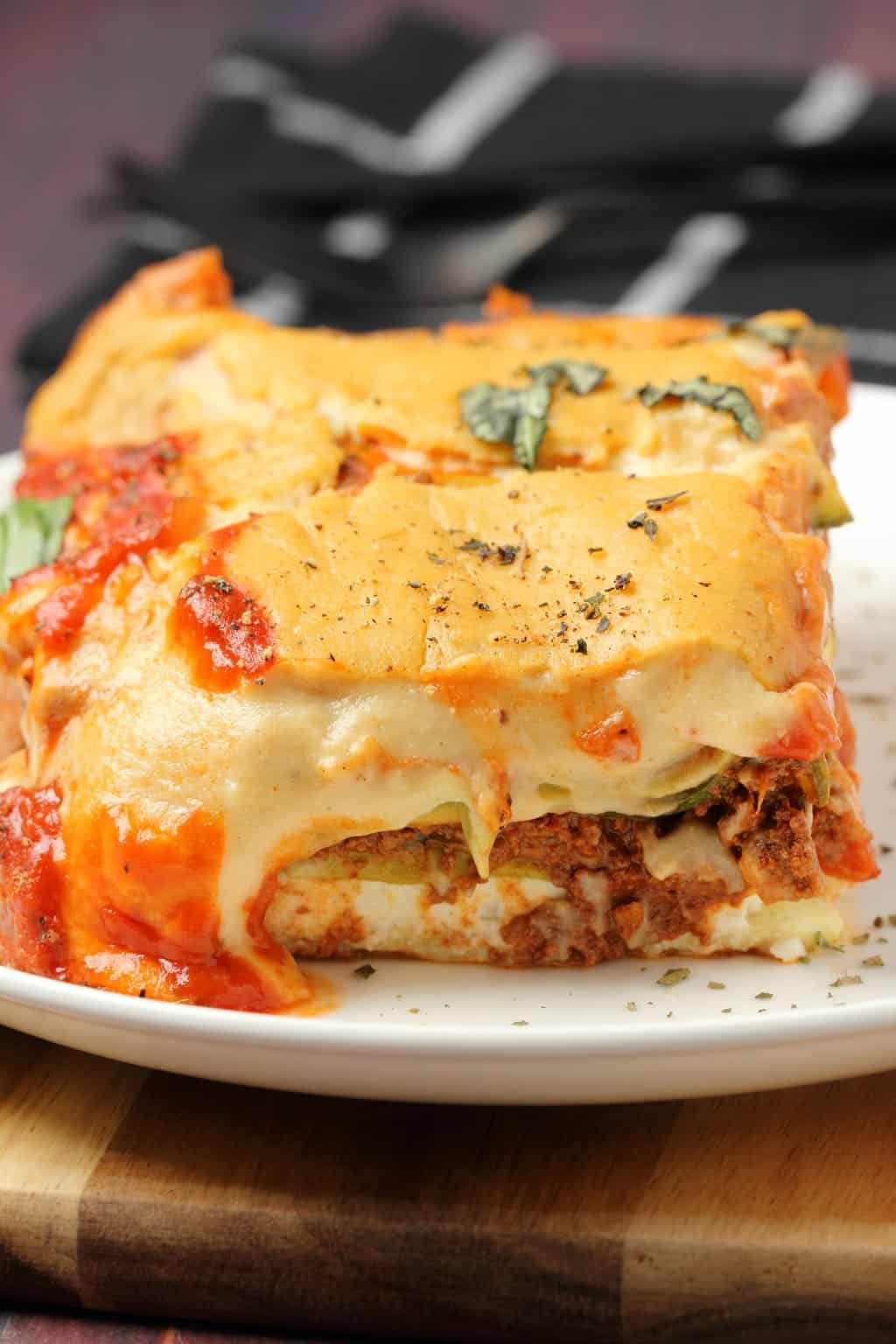 A slice of vegan lasagna on a white plate.