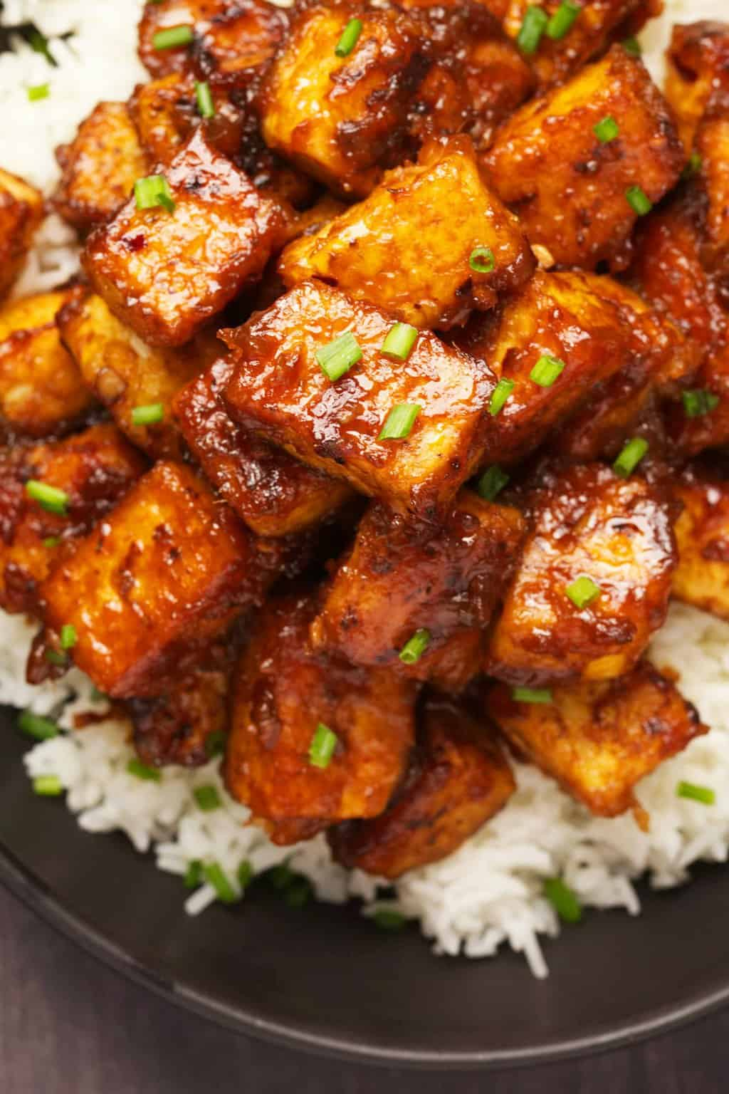 General Tso's tofu served with basmati rice and chopped chives.
