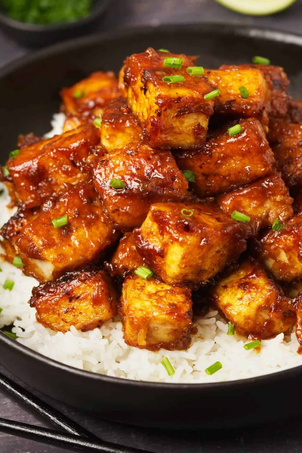 General Tso's tofu served over basmati rice with chopped chives.