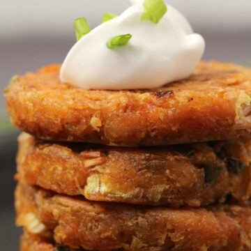Vegan hash browns topped with a dollop of vegan mayo and chopped spring onions