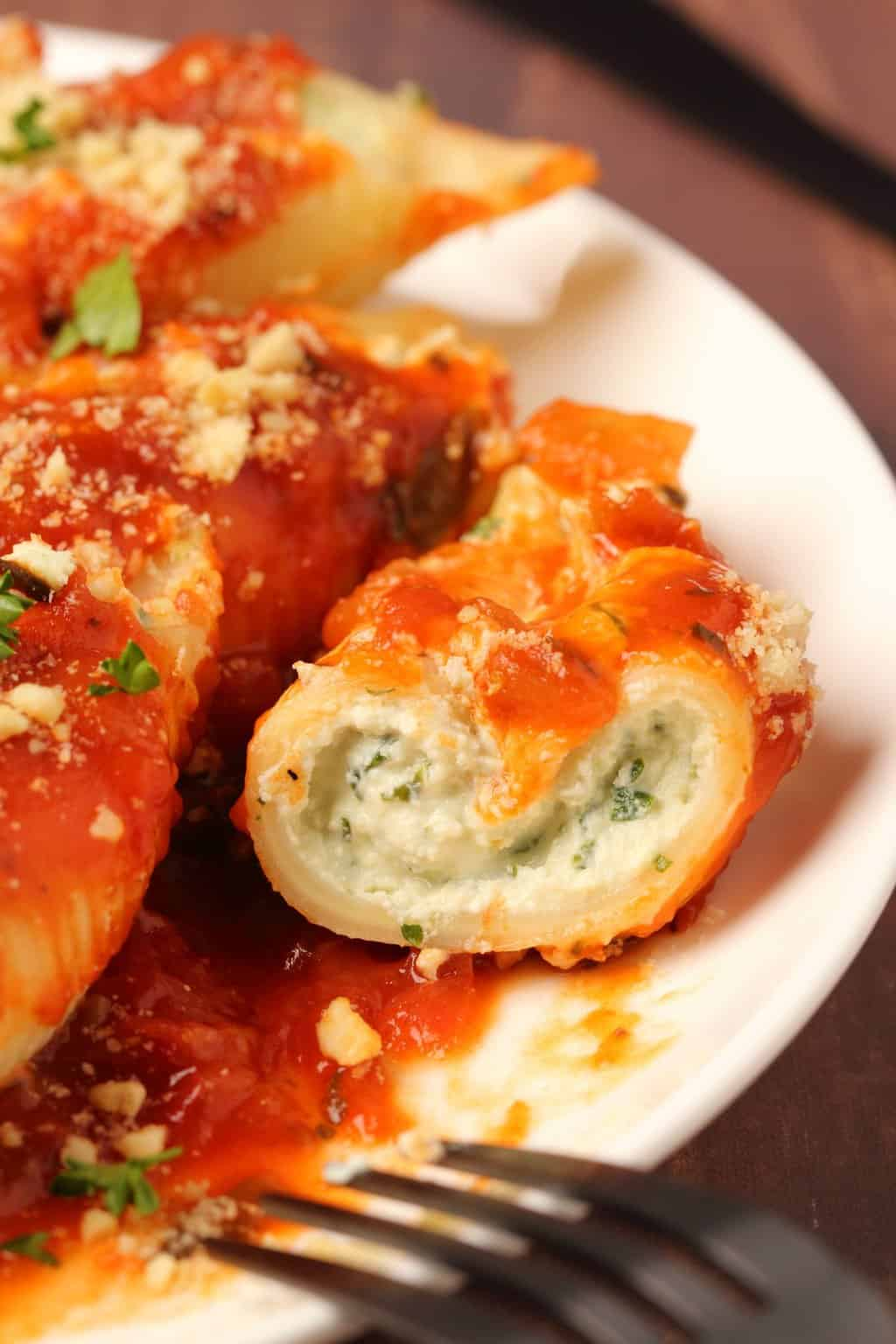 Vegan stuffed shells on a white plate.
