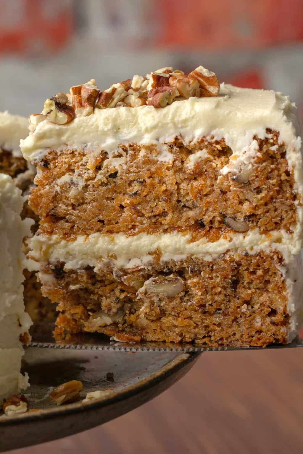 Slice of vegan gluten free carrot cake on a cake lifter.