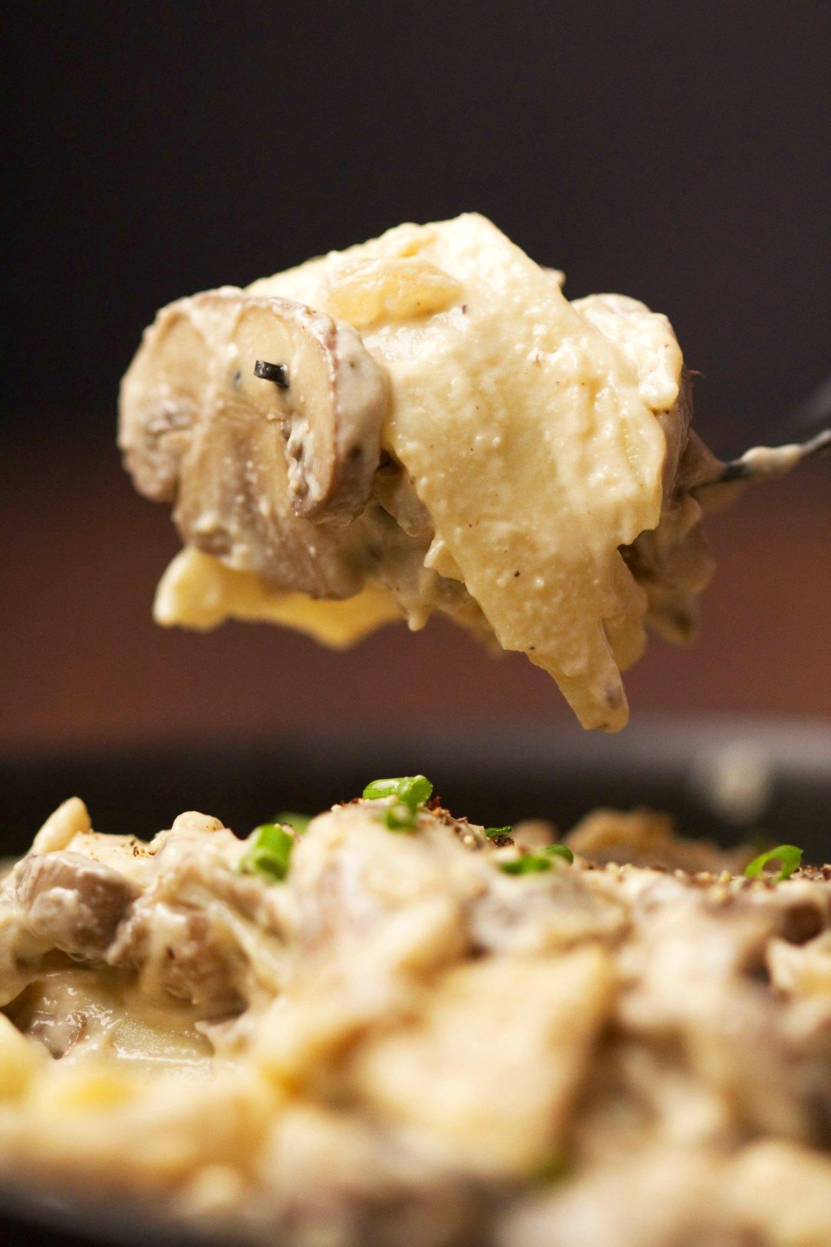 A forkful of vegan mushroom stroganoff.
