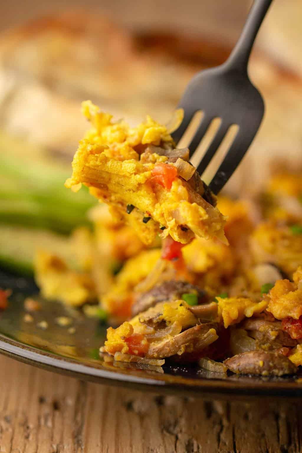 A forkful of vegan scrambled eggs.
