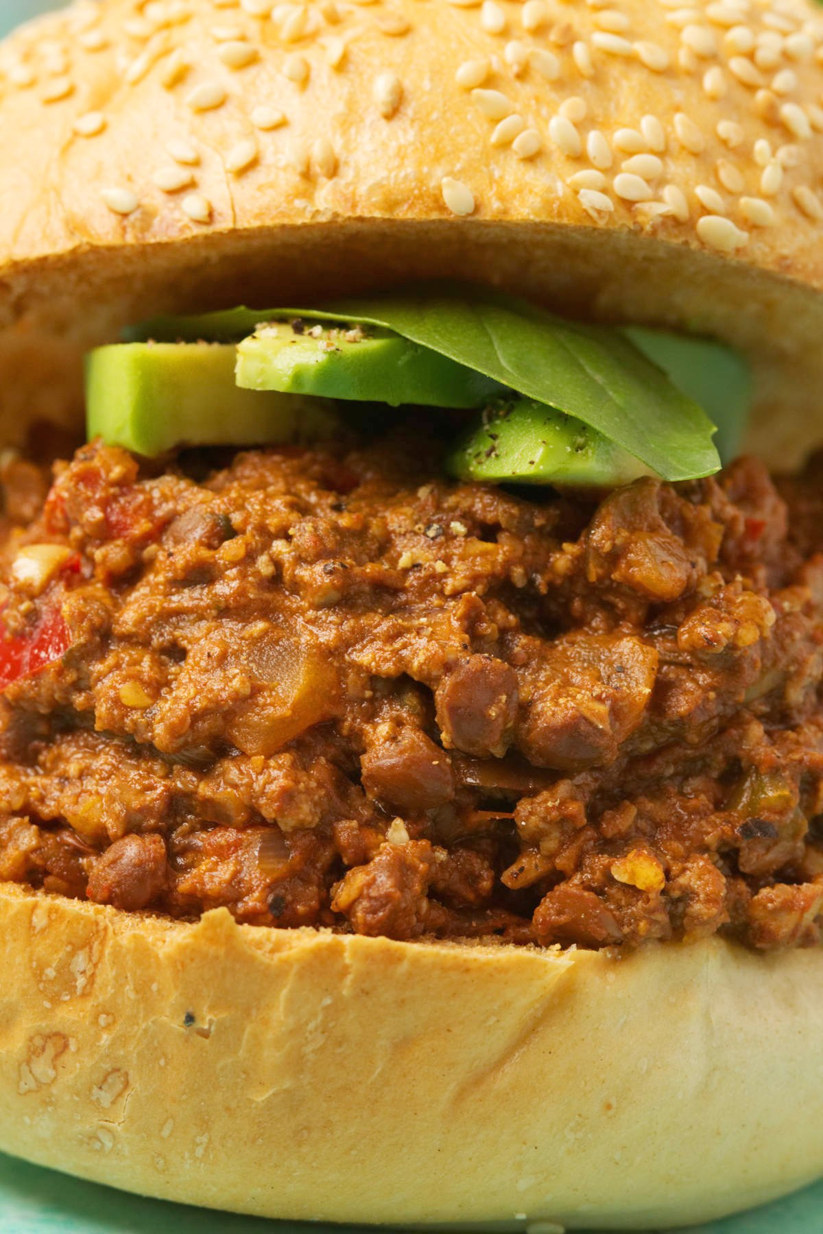 Vegan Sloppy Joe with sliced avocado and fresh basil.