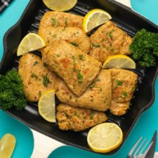 Vegan chicken with fresh lemon and parsley in a grill pan.