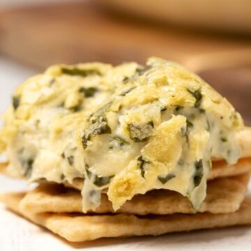 Vegan spinach dip on crackers