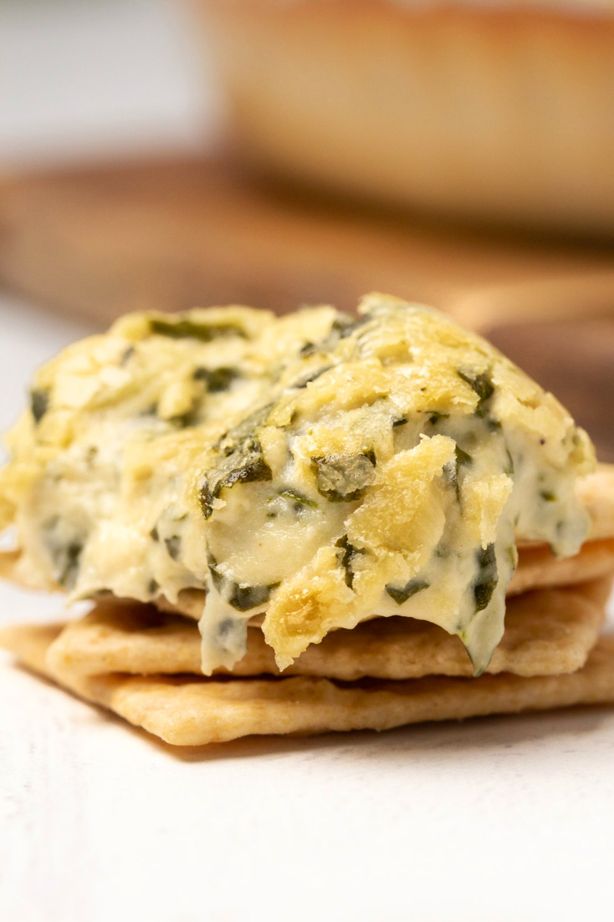Vegan spinach dip on crackers.