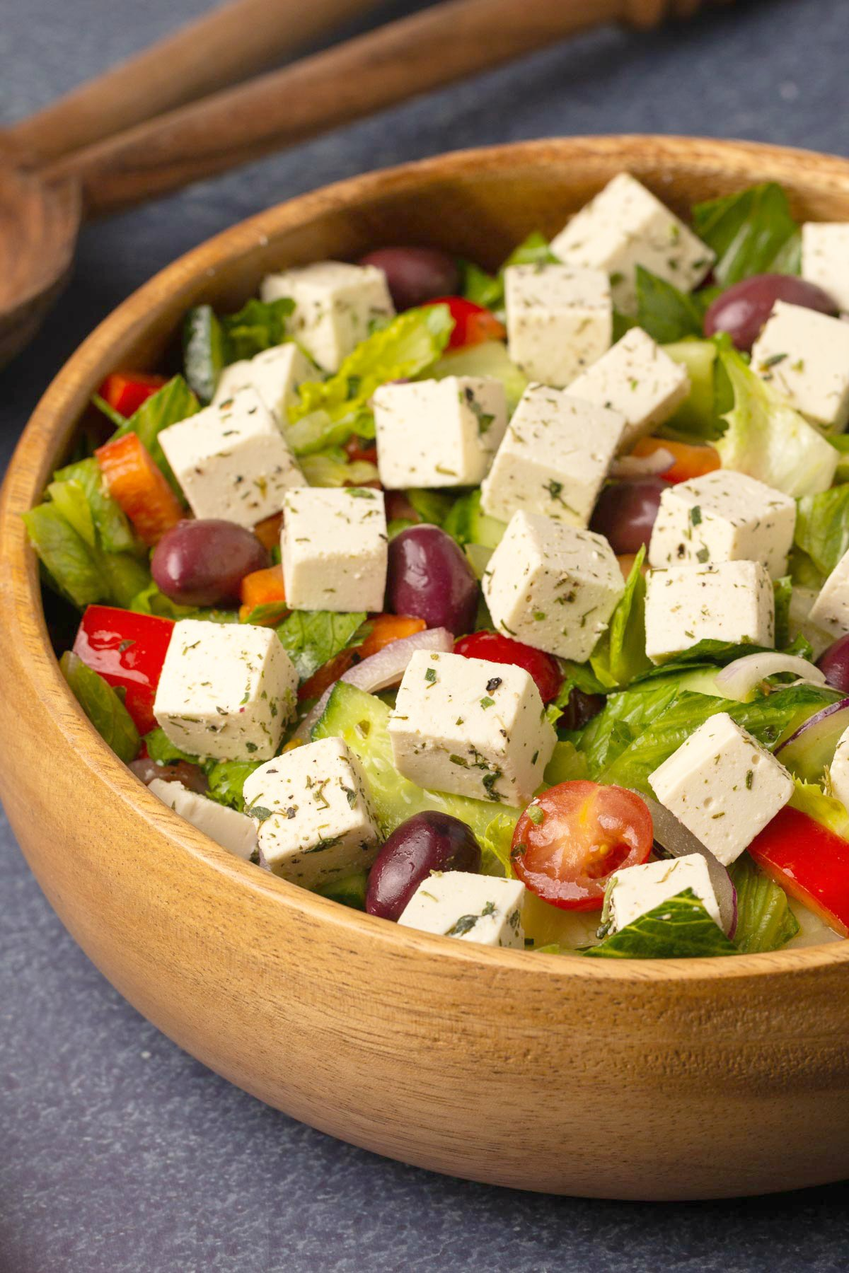 Vegan feta cheese on top of a Greek salad.