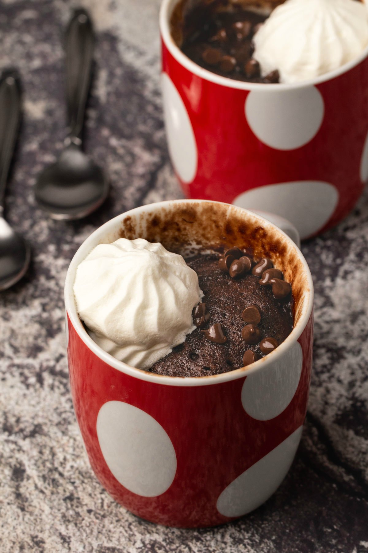Vegan mug cake in a red and white mug.