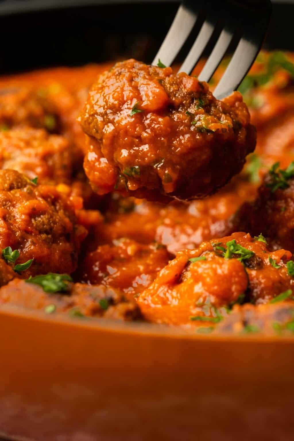 Vegan meatball on a fork.