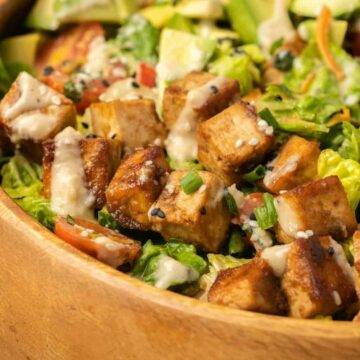 Tofu salad in a wooden bowl.