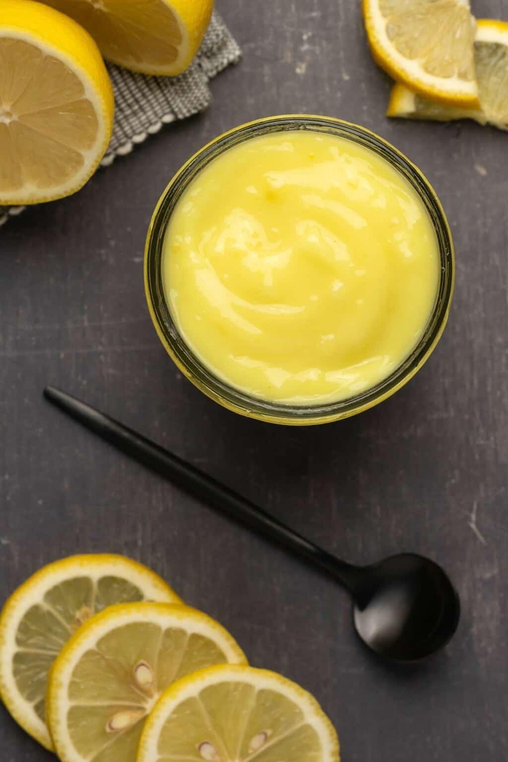 Vegan lemon curd in a glass jar.