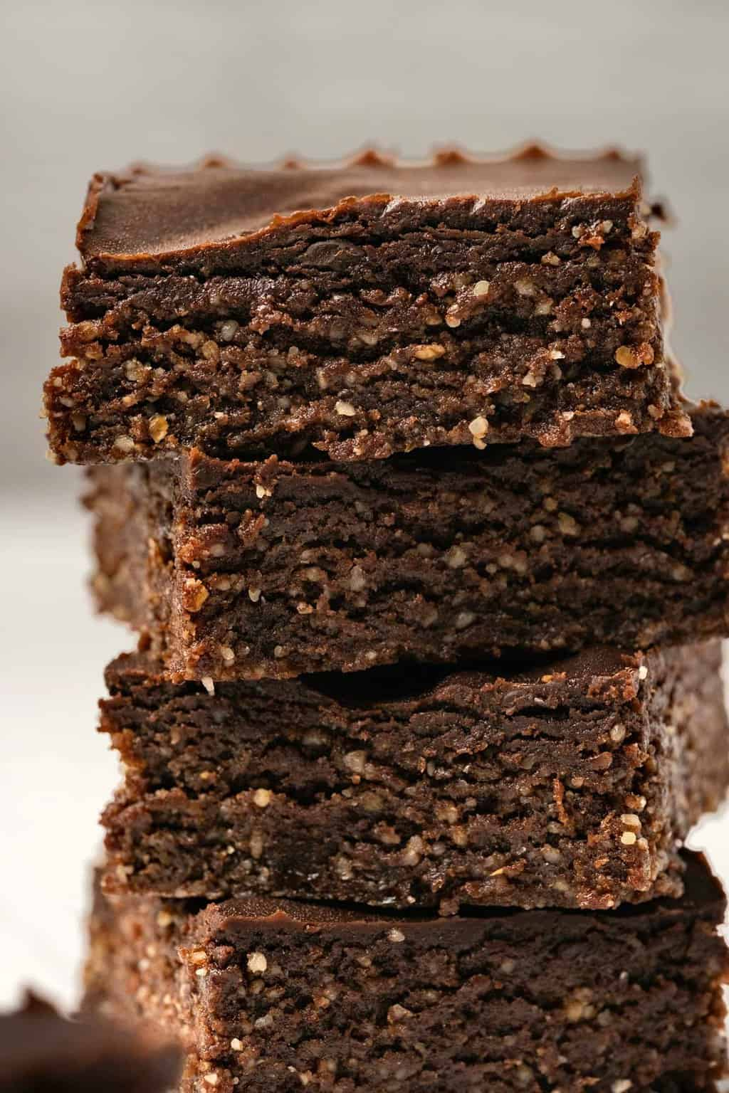 Stack of four vegan brownies.