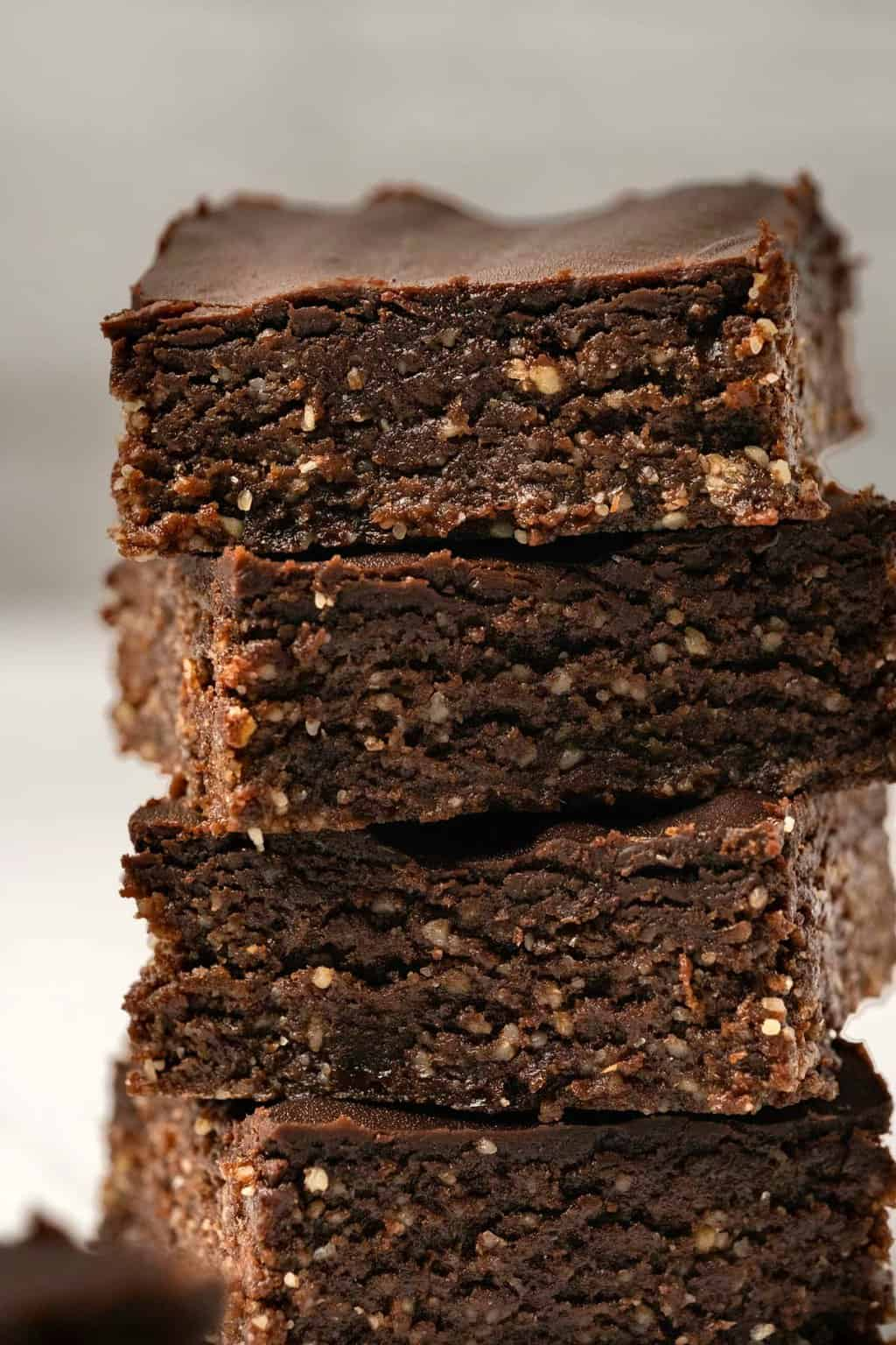 Raw vegan brownies in a stack.