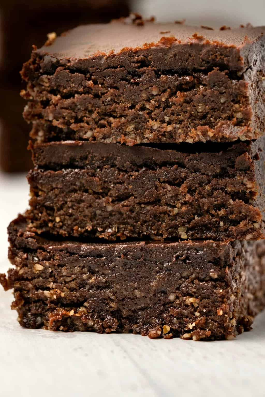 Stack of raw vegan brownies.