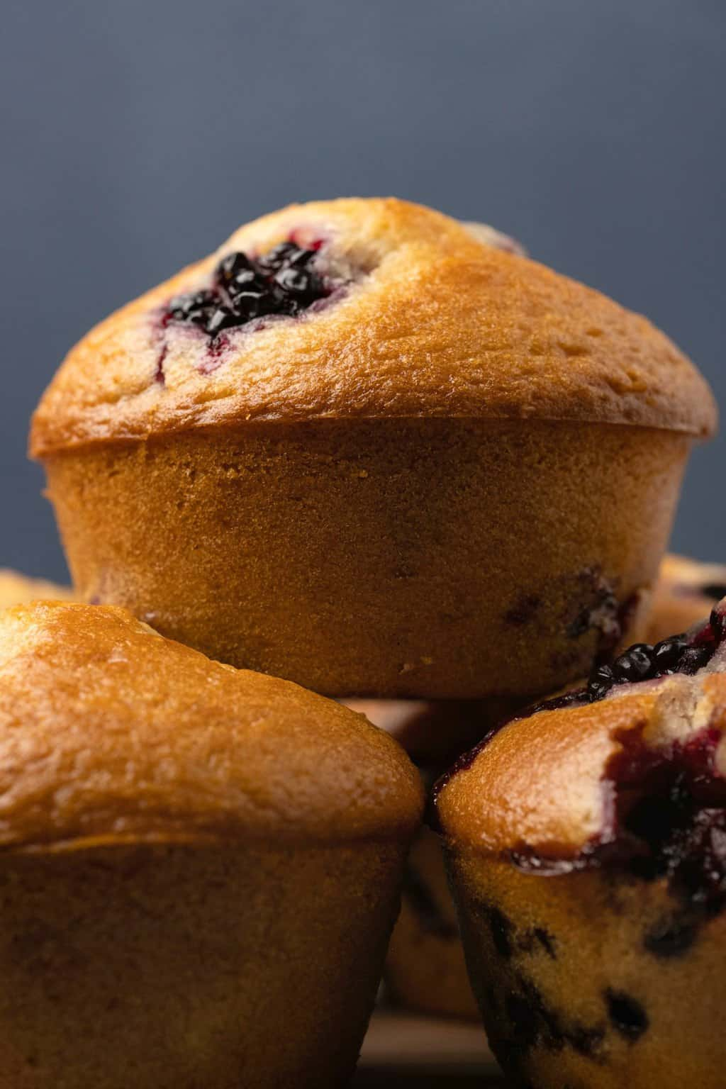 Vegan blackberry muffins in a stack.