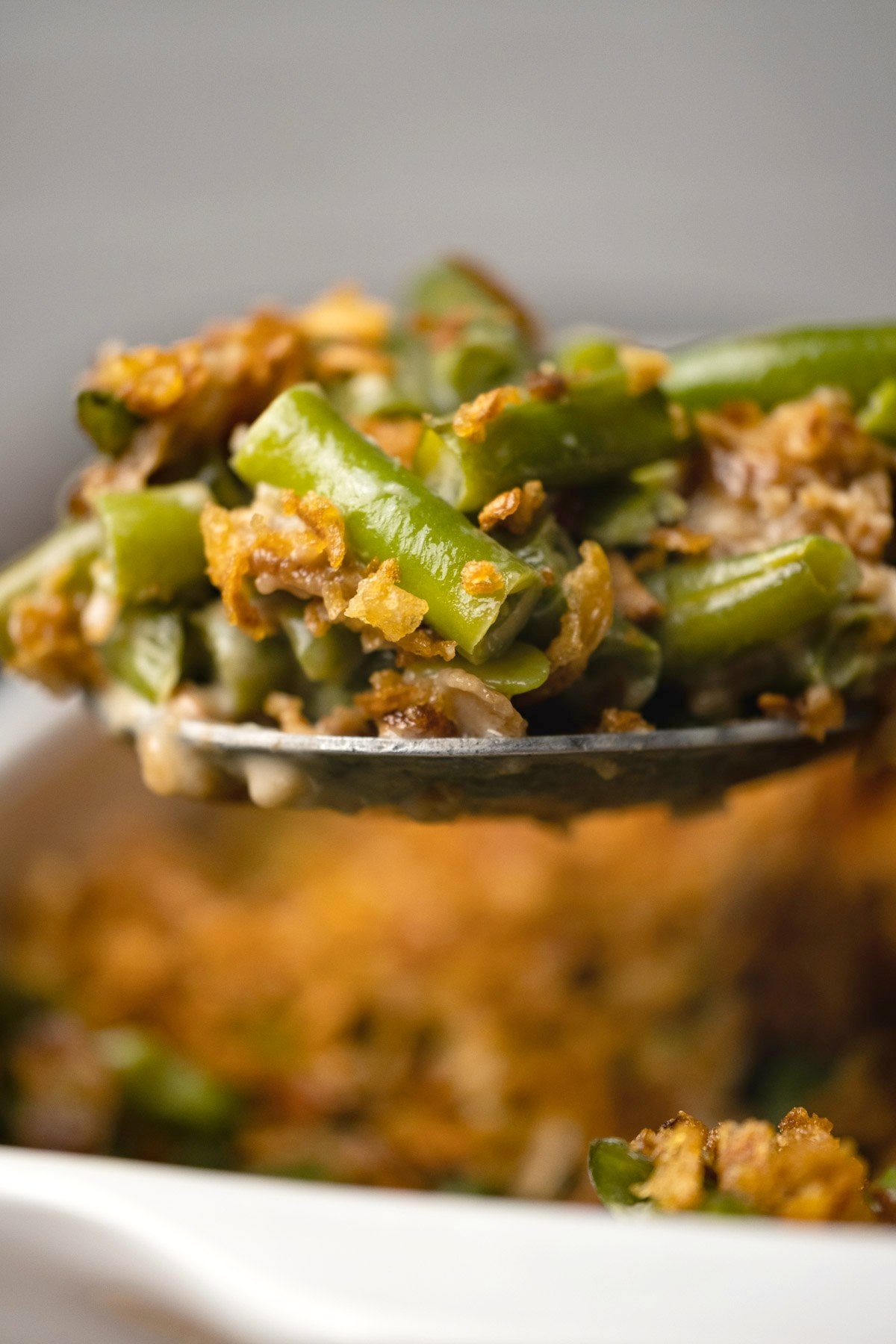Serving spoon with green bean casserole.