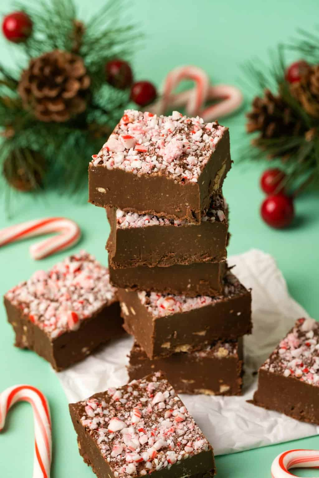A stack of vegan peppermint fudge topped with crushed candy canes.
