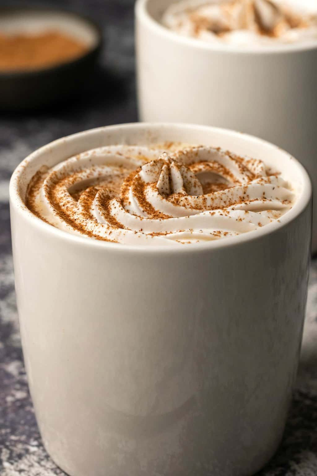 Vegan pumpkin spice latte in a white mug.